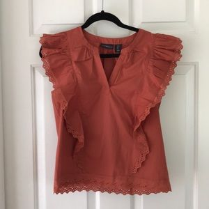 rust-colored blouse
